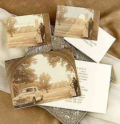 old vintage photos scattered on table tops at vintage wedding