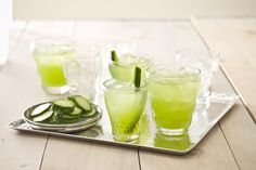 6  medium cucumbers  1/2   cup sugar  1/2   cup water  1-inch piece of fresh ginger peeled and sliced  6 tbsp fresh lime juice  8 ounces white rum *** Rose, I'm think'n forget the rum and try your Skinny Girl C' Vodka***