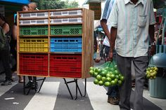 I love how the plastic fruit crates are transformed to a modern furniture. I use it to store the kids' toys.