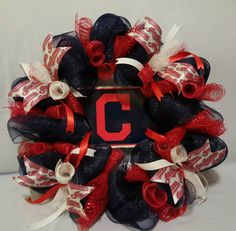 Check out this item in my Etsy shop https://www.etsy.com/listing/500947913/cleveland-indians-inspired-wreath-custom