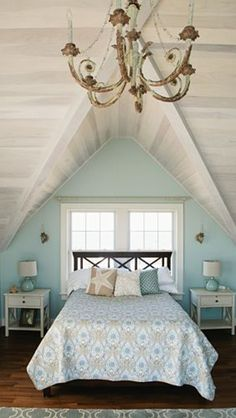 White washed ship lap wood ceilings in this master bedroom on the ocean