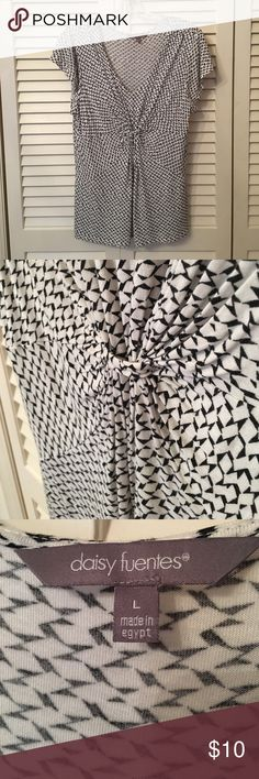 EUC - Fun Daisy Fuentes Geometric Print Top EUC - Fun geometric white and black print top gathered in front. Picture shows faux loop. I used to wear a sparkly pin with color here for fun. Looks great alone, under a suit jacket, or sweater. Fabric is light and loose fitting.   Smoke free home. Best price/value in bundles - I offer 25% off for 3+ items. Thanks for looking!!  .                                                                  25% off of an $8 -> $6…