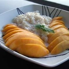Thai Sweet Sticky Rice With Mango (Khao Neeo Mamuang) *use rice cooker, adding the rice plus two cups coconut milk, one cup water, and 1/2 cup sugar