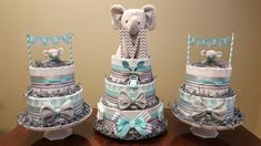 Elephant baby shower! Teal and grey elephant diaper cake and matching  mini's. Check out my Facebook page Simply Showers for more pics and orders.