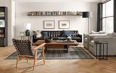 Love the single long bookshelf w/ photos under it - Room & Board