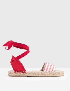 Sashay straight to the seaside in these nautical cotton canvas espadrilles. Playful rope trims and grosgrain ankle ties add the finishing touch to either red or blue stripes. Don't have a holiday booked? These are stylish enough for beachcombers and city slickers alike.