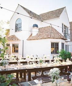 Perfect backyard reception, with long tables and many small wedding cakes to lend a fun, picnic feel.