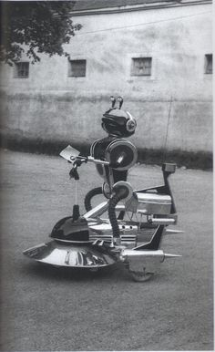 'Cosmos the Robot' created by Christian Dupont, 1958 (French) ~ Operated by remote control, Cosmos was a big hit. Dupont exhibited the robot at fairs and circuses in the 1950s and won an award at the Intl Exhibition of Invention Of Monaco in 1960. Cosmos was described as elegant and sophisticated. It drove forward, backward, turning right or left by a single swivel wheel under the saucer. The head had slight realistic movement, and its speech was perfectly synchronized with the mouth.
