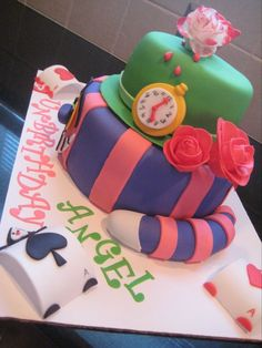 Alice in Wonderland UN Birthday Cake - side shot to show chesire cats tail and pocketwatch also playing card guard.