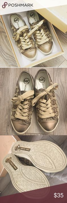 Michael Kors Monogram Jacaquard Sneakers 6 Gently worn Michael Kors Monogram Jacaquard sneakers   Gold/tan color  Minimal signs of wear. Probably wore 3 or 4 times for a few hours  Comes with box Michael Kors Shoes Sneakers