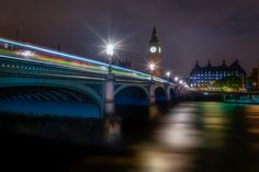 A classic shot of Westminster and Big Ben, well only the tower, Big Ben is only the bell inside the tower. A London double decker bus crosses the bridge. And under the bridge you see the muddy River Thames. Photo by: Jacob Surland, www.caughtinpixels.com