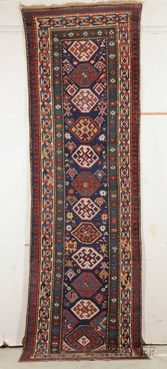 Talish Long Rug, Southeast Caucasus, last quarter 19th century,  10 ft. 8 in. x 3 ft. 2 in.    Skinner Auctioneers