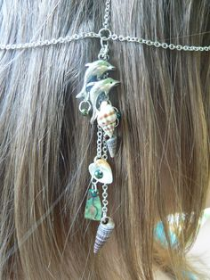 beach dolphin head chain ablone head piece halo dolphins abalone shells in belly dance boho gypsy hippie beach and hipster style. $24.00, via Etsy.