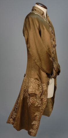 Coat, Europe, c. 1750. Brown silk satin, extensively decorated with pink and ivory floral embroidery, embroidered self buttons, silk lining.