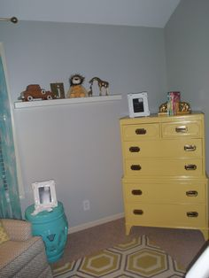 Yellow dresser we just refinished for Jude's nursery.  Added campaign style hardware.