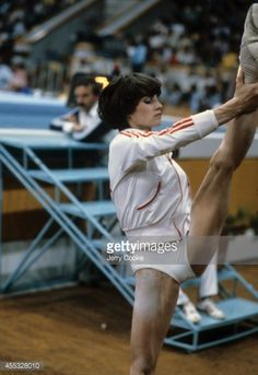 View of Romania Nadia Comaneci stretching during warmups before Women's event at Sports Palace of the Central Lenin Stadium. Moscow, Soviet Union 7/23/1980 - 7/24/1980 Jerry Cooke X24706 TK4 R9 F28 )