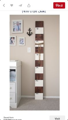Great wood and white two-tone DIY height board for a nursery or kids room.
