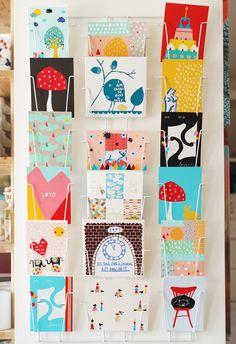 postcard sized artwork in card rack