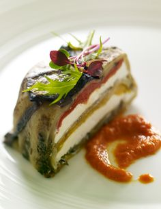 Eggplant & Goat Cheese Torte with Honey-Harissa Sauce. Eggplant is the star of this modern interpretation of a vegetable terrine. Honey-Harissa Sauce adds vibrant color and bold flavor. Inspired by our 2012 Flavor Forecast.