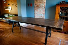This 9 foot long walnut dining table was created using walnutwhile adding breadboard ends and recessed bolts. A tornado ripped out huge walnut treesfrom Seacliff Park in Leamington, Ontario. I was able to reclaim this wood and bring it back to something funtional. The cast iron base are vintage industrial machine legs.