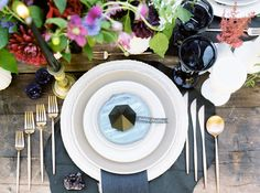 Blue, gray and gold tablescape with diamond plate settings