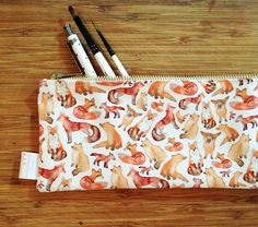 Adorable watercolour painted little foxes! Perfect as pencil case, and for storing stationery, make up or anything else you might fancy. This small bag is a convenient size and will comfortably fit in most handbags or rucksacks, so these super cute foxes can come with you wherever you go! The design was originally hand painted in watercolour and then digitally printed in London onto strong, great quality fabric, which was then sewn together by me from my home in Wiltshire…