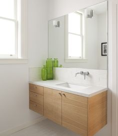 Wall mounted sink and vanity; would love to do this in the upstairs bathroom of Bearsville in the future.