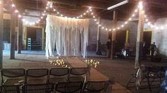 My friend @amynicole662 got married in this beautiful warehouse. Loved the decor. Fabric altar area, live band, burlap aisle, white lights and candles on the wooden floor. #hickmanwedding