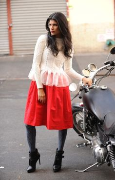 Love the sweater, minus the motorcycle & red skirt!  The Daily News rounds up the best sweaters and knits for fall and winter.