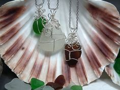 Necklace made with wire and sea glass. This necklace was made the same way using an lense from old glasses instead of sea glass: http://dollarstorecrafts.com/2012/06/make-a-glasses-lens-pendant/
