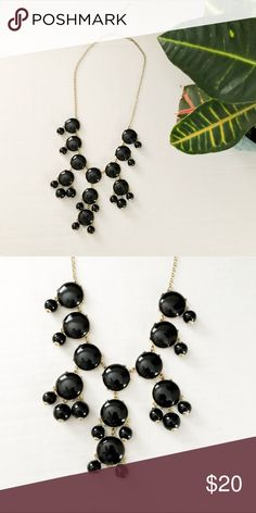 Bubble Drop Statement Necklace Bubble drop Statement necklace. Size: 16.5 inches at the longest. Color: Black and Gold. Classic statement necklace that will pop with any outfit. Gold chain and details around smooth lacquer bubbles. Jewelry Necklaces