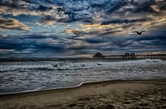 Huntington Beach Pier Stormy Sunset by Mik Munki on 500px
