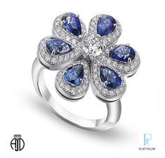 American Jewelry Designs, Inc. platinum ring with diamonds and pear-shaped sapphires.