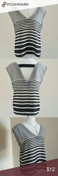 Black and White Striped vneck Top Black and white stripe top is a great versatile piece. Vneck in front and back. Strap detailing in back also. 100% polyester. 4th pic shows it paired w/ an American Eagle jean jacket, which is sold separately. Forever 21 Tops Blouses