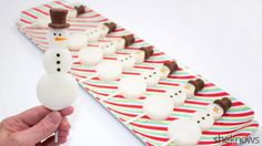 Piña colada Jell-O shots in snowman form are the most festive way to get your holiday drink on