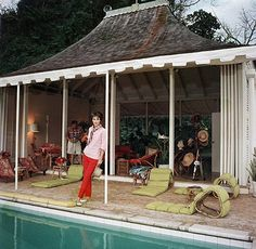 Babe Paley, socialite and fashion icon in a photo by Slim Aarons, standing on a patio in Round Hill, Jamaica.