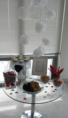 """""""Love is Sweet...Please Grab a Treat!""""    A """"sweets"""" table is a must for a bridal shower.  Check your local supermarket for sales on candy and cookies to make a big impact on a small budget."""