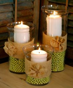 Spring Hurricane Vases/Burlap Rosettes---These would be cute for a country wedding, centerpieces. Diy Candle Centerpieces, Diy Candles, Burlap Candles, Wedding Centerpieces, Fall Candles, Centerpiece Ideas, Vase Ideas, Table Decorations, Ideas Candles