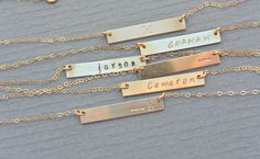 A personal favorite from my Etsy shop https://www.etsy.com/listing/203174573/personalized-bar-necklace-nameplate