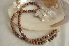 Silver Leaf and Wood Bead Necklace by lizrubi on Etsy, $39.00