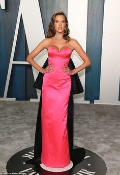 Making a statement: Alessandra was hard to miss in her eye-catching attire...