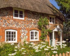 A pretty thatched cottage at Haxton in Wiltshire | by Anguskirk