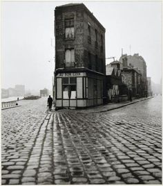 Henri Cartier Bresson - scale, leading lines; eye goes right to the person