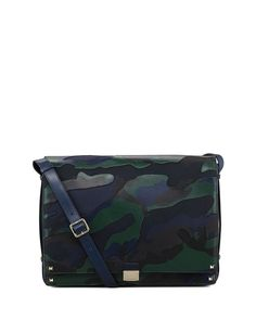 Camouflage is generally used for blending in, but you'll definitely stand out with this Valentino messenger bag. Camo-print canvas and leather. Platino hardware includes signature Valentino Rockstuds. Adjustable crossbody/shoulder strap with padded i...