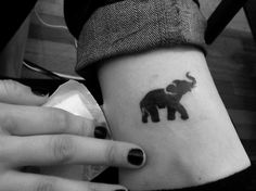This is my friends elephant tattoo that I accompanied her in getting today. Elephants with their trunks up are good luck, and its her charm. Done at Stingray Body Arts in Allston, MA