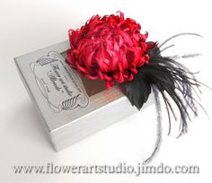 Handmade various shades of red fabric chrusanthemum brooch with black color leaves and feathers.  * * * * * *  The brooch size is about 8 cm /
