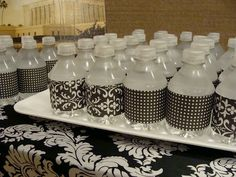 This was done with scrapbook paper...but I have seen it done with decorated duct tape as well...a neat way to dress up water bottles!