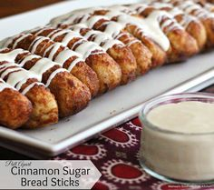 Pull Apart Cinnamon-Sugar Bread Sticks With Cream Cheese Dip - Bread sticks are tasty in any flavor. Cinnamon-sugar bread sticks are a genuine treat.