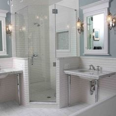 tub and separate shower modernized the space but maintained the vintage feel of this 1929 home.Medicine Cabinet, Sconces