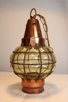 Copper and blown glass arts and crafts hanging lantern . Re wired with silk woven flex. Measures 8 in diam 13 in high ( 20 in with chain )